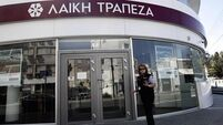 Cyprus banks reopen; some customers call it 'chaos'