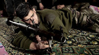 Syrian rebels fight Palestine group