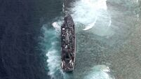 US Navy ship runs aground after map mistake