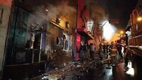 At least 180 now thought dead in Brazil nightclub blaze