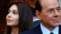 Berlusconi blames 'feminist, communist' judges for divorce payout