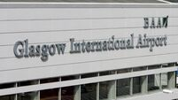 Four hospitalised after plane evacuated in Glasgow