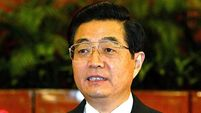 Chinese leader quits as party chief