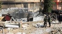 Blasts hit army headquarters in Damascus