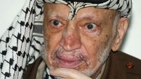 Yasser Arafat's remains exhumed in search for clues to cause of death