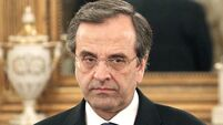 Samaras hails 'new day' as Eurozone approves money for Greece