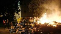 Residents of Spanish city burn rubbish on streets