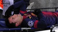 Messi stretchered off as Barca held to draw