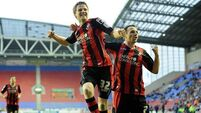 Wigan escape shock cup exit to Bournemouth
