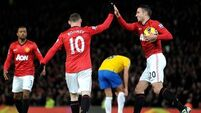 Too early to call title, insists Rooney
