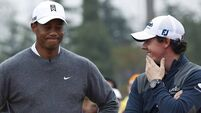 McIlroy edges out Woods in China golf shootout