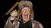 McCririck 'improving' after health scare