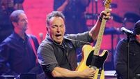 Springsteen doubtful he's a good influence on Australian Treasurer Swan