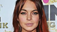 Lohan 'booted out of home' after falling behind on payments