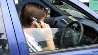 23,000 people fined for using mobiles while driving