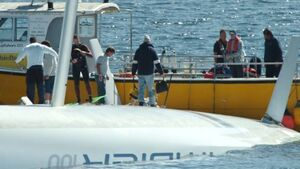 Crew of capsized yacht couldn't get to lifesaving gear
