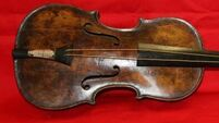 Violin played as Titanic sank is found in attic