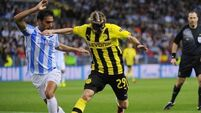 Malaga ride their luck as Dortmund rue missed chances