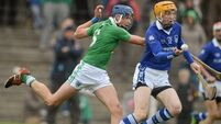 Tipp  champions   to  prevail in   tight  game