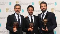Rain-soaked Baftas leave stars in black on the red