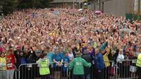 Weather fails to deter eager mini-marathoners