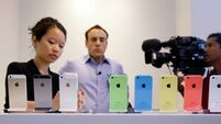 Shares fall 6% after iPhones launch