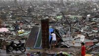 Battle for  aid to reach   typhoon survivors