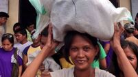 Families  continue to flee areas worst hit by Haiyan