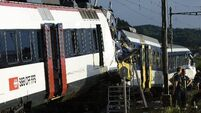 At least 35 hurt as two Swiss trains collide