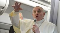 Pope Francis says he won't judge gay priests