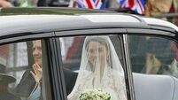 Here comes the beaming bride - Kate arrives at the Abbey