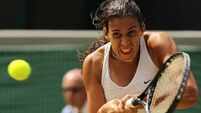 Bartoli leaves painful past behind to dream of next slam