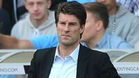 No time  to panic, Gus, says Laudrup