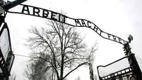 Court charges three over Auschwitz sign theft