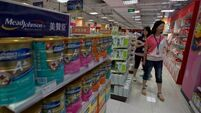 China threatens to 'severely' punish  milk powder producers after   scare