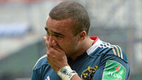 Munster winger Simon Zebo tries to hide his disappointment