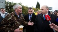Ministers heckled as they survey ruined homes