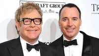 Elton John and Furnish planning low-key wedding