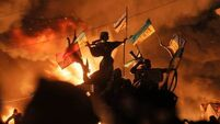 13 dead in Kiev as  riot police storm camp