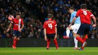 Aguero back as City rout Rovers