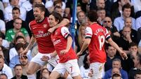 Gunners stay in hunt as Sherwood's strife grows