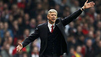 Wenger to stay cautious