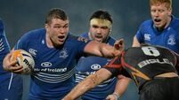 Leinster survive scare to hit top spot