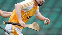 Antrim's late flurry sees off 14-man London