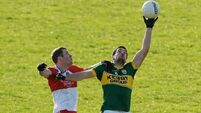 Youthful Derry dig in to keep Kerry at bay