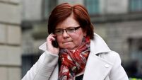 Farrell leaves court over queries about male friend