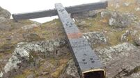 Mountains of help on offer to re-erect vandalised cross