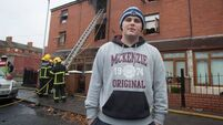 Local hero catches tot flung from house blaze