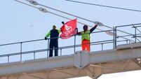 Duo occupy crane over money owed