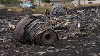Wreck recovery under way at MH17 crash site